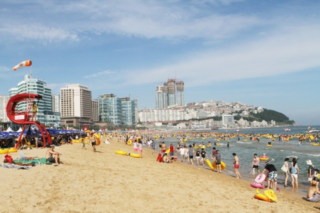 Busan's Haeundae Beach is a big annual draw for Koreans and foreign tourists seeking fun in the sun and surf. For a small price beachgoers can rent an umbrella, pad and inflatable tube for a day. Hotels and restaurants are minutes away from the beach.