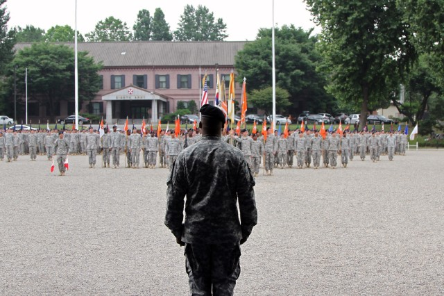 Col. Arvesta P. Roberson, 1st Signal Brigade Commander, stands in front of the Brigade alone in front of his formation at the Change of Command Ceremony at USAG Yongsan's Knight Field July 16, 2014. Roberson became the 30th commander of the 1st Signal Brigade, the backbone of all things Signal in the Republic of South Korea. (U.S. Army Photo by Spc. Gregory T. Summers)