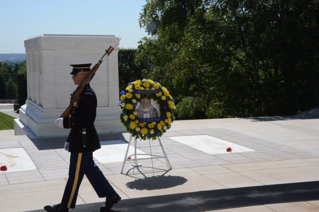 A tomb sentinel guards the Tomb of the Unknowns, following a wreath-laying ceremony by the U.S. Army Chaplain Corps in Arlington National Cemetery, Va., July 25, 2014.