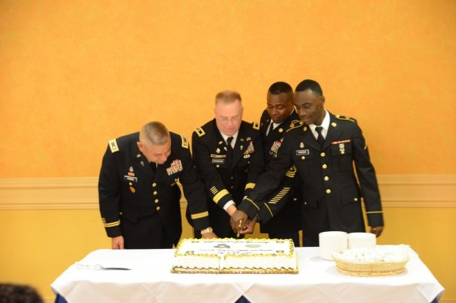 (From left to right) Chaplain (Lt. Col.) Timothy L. Hubbs, Arlington National Cemetery chaplain; Chaplain (Maj. Gen.) Donald L. Rutherford, U.S. Army chief of chaplains; Sgt. Maj. Alvin J. Chaplin, regimental sergeant major of the Chaplain Corps; and  Pfc. Porter, the youngest chaplain assistant in the Chaplain Corps.