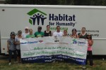 ATEC personnel volunteers with Habitat for Humanity