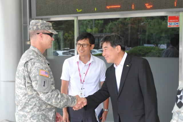 "CAMP CASEY, South Korea -- Col. Michael Lawson, the commander of 210th Field Artillery Brigade, 2nd Infantry Division, shakes hands with Mayor Oh Se-chang, the mayor of Dongducheon, after becoming an honorary citizen of Dongducheon July 28, 2014 at Dongducheon City Hall, in Dongducheon, South Korea.  Mayor Oh thanked them for their service and their hard work to better the relationship with the local communities. ""I would like to thank Col. Lawson and Command Sgt. Maj. Brinton for helping out within local communities such as the English Village program,"" said Oh. ""I would also like to have these relationships continue between Soldiers and the city of Dongducheon."""