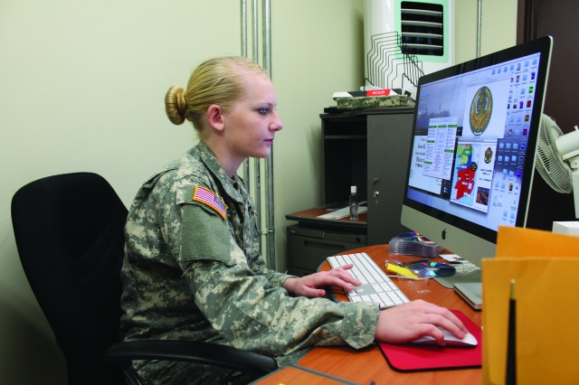 PFC Hayley Kate Gardner, HHC, USAG Daegu is all about attention to detail as she works with computer-generated art work