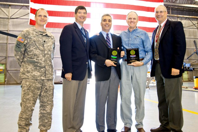 (From left) Lt. Col. Carl Ott; Jyuji Hewitt, deputy director of the U.S. Army Research, Development and Engineering Command; senior aerospace engineer Hossein Mansur; senior aerospace engineer Matt Whalley; and Barry Lakinsmith, director of the Aviation and Missile Research, Development and Engineering Center's Aeroflightdynamics Directorate, at Ames Research Center, Moffett Field, Calif., June 3, 2014. Mansur and Whalley received their Research and Development Achievement Awards.