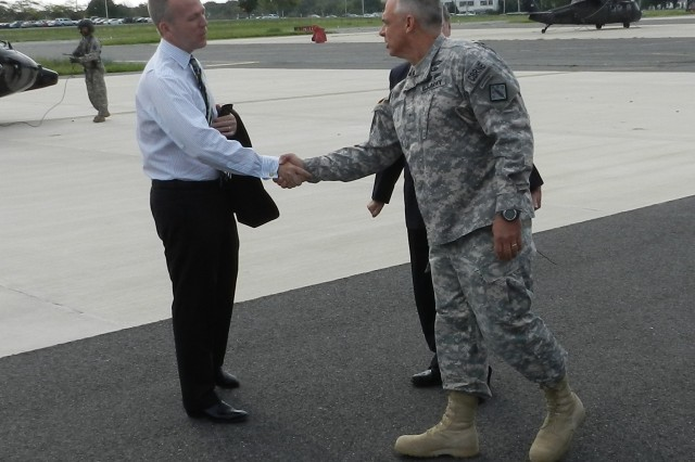 Army Under Secretary Brad Carson (left) meets Brig. Gen. JB Burton, commander of the 20th CBRNE Command (Chemical, Biological, Radiological, Nuclear, Explosives), at Aberdeen Proving Ground's (Md.) Edgewood Area, July 29, 2014.