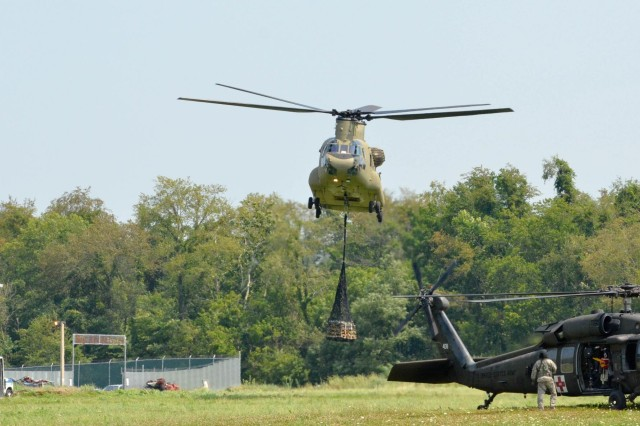 A CH-47 Chinook helicopter drops a simulated sling load