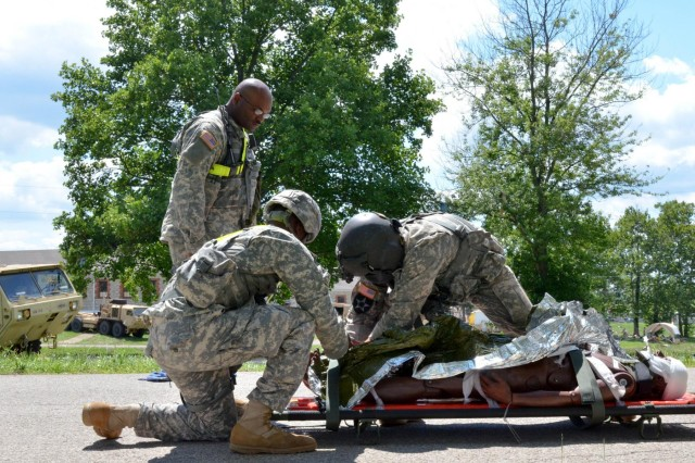 A flight medic assigned to 2nd Battalion, 4th Aviation Regiment, 4th Combat Aviation Brigade, Fort Carson, Colorado, evaluates a simulated casualty before transporting him to a medical facility at Muscatatuck Urban Training Complex, Ind., July 24, 2014. Vibrant Response is a major field training exercise conducted by the U.S. Northern Command and led by U.S. Army North. Approximately 5,000 service members and civilians from the military and other federal and state agencies throughout the country are training to respond to a catastrophic domestic incident. As a component of U.S. Northern Command, Army North coordinates timely federal and military response to disasters in the homeland to help the American people in a time of need. (U.S. Army photo by Sgt. Brandon Anderson 13th Public Affairs Detachment/Released.)