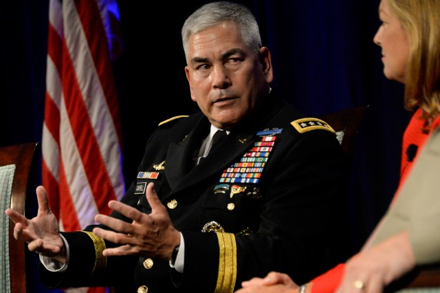 Army Vice Chief of Staff Gen. John F. Campbell discusses education with  DeEtte Gray, president of BAE Systems Intelligence & Security, during a panel at the Military Child Education Coalition National Training Seminar in Washington, D.C., July 29, 2014.