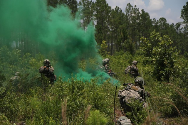 Soldiers of Company B, 3rd Battalion, 7th Infantry Regiment, 4th Infantry Brigade Combat Team, 3rd Infantry Division, out of Fort Stewart, Ga., defends their position against oncoming soldiers of the Florida National Guard 53rd Infantry Brigade Combat Team during the eXportable Combat Training Capability exercise at Camp Blanding, Fla., July 26, 2014. XCTC is a training event meant to enhance the combat readiness of Army National Guard units. (U.S. Army Photo by Sgt. Joshua Laidacker, 4th IBCT, 3rd ID, Public Affairs)