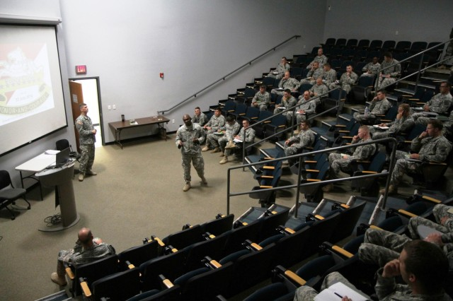 Command Sgt. Maj. Craig Copridge, center, the senior enlisted adviser for 6th Squadron, 8th Cavalry Regiment, 4th Infantry Brigade Combat Team, 3rd Infantry Division, discusses the expectations for  Mustang Leadership Development on July 22, 2014 at the Sgt. 1st Class Paul R. Smith Education Center on Fort Stewart, Ga. Mustang Leadership Development is designed to measure a leader's knowledge and identify their strengths and weaknesses in order to help leaders  grow professionally and personally. (Photo by Sgt. Joshua Laidacker, 4th IBCT, 3rd ID, Public Affairs)