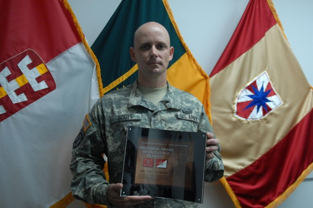 Sgt. 1st Class Tony W. Scott, the equal opportunity adviser for the 130th Engineer Brigade, poses with his recent award, the Army Individual Award of Excellence in Safety, the top individual safety award in the U.S. Army, July 22, at Fort Shafter, Hawaii. Scott was chosen from more than 50 Army installations across the world. (U.S. Army photo by Staff Sgt. John Garver, 8th Theater Sustainment Command Public Affairs/Released)