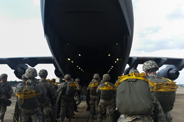 Paratroopers assigned to 3rd Battalion, 319th Airborne Field Artillery Regiment, 1st Brigade Combat Team, 82nd Airborne Division, prepare to board a C-17 Globemaster, July 29, at Fort Bragg, N.C. (U.S. Army photo by Staff Sgt. Mary S. Katzenberger)