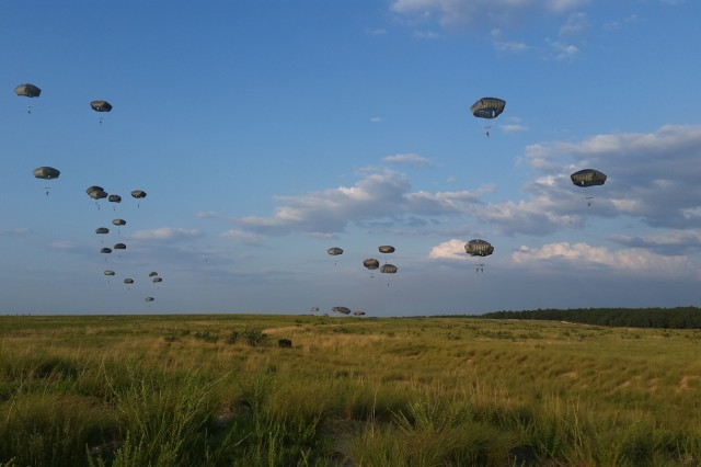 Paratroopers assigned to 3rd Battalion, 319th Airborne Field Artillery Regiment, 1st Brigade Combat Team, 82nd Airborne Division, descend toward Holland Drop Zone, July 29, at Fort Bragg, N.C. (U.S. Army photo by Staff Sgt. Mary S. Katzenberger)