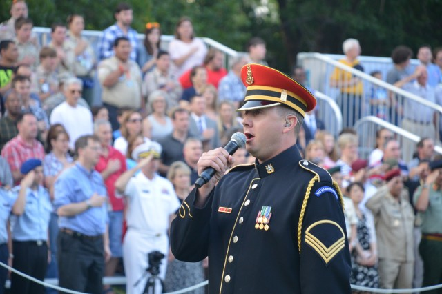 "A Soldier from the U.S. Army Band ""Pershing's Own"" performs during Twilight Tattoo held at Joint Base Myer-Henderson Hall, Va., July 30, 2014."