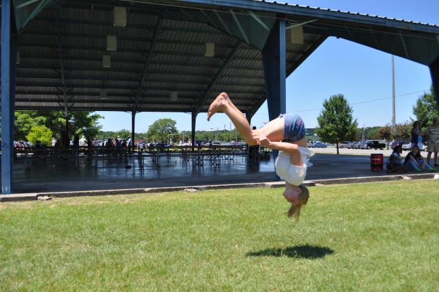 Julie Lloyd completes a back flip during a tumbling run. She is the daughter of Joy Lloyd, ACC Contracting Operations, Policy Division.