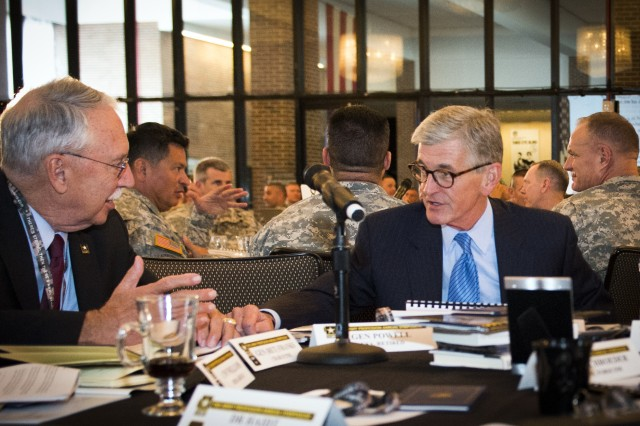 Secretary of the Army John McHugh (right) talks with retired Gen. Fred Franks during the Army Profession Symposium held at the U.S. Military Academy at West Point, N.Y., July 30, 2014. (U.S. Army photo by Mr. John Martinez)