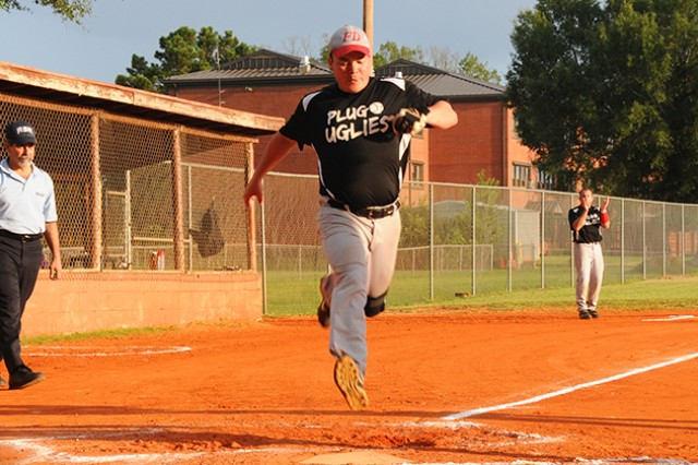 A player for Fire Dept. Plug Uglies scores a run during the Fort Rucker Intramural Softball Championship game at the intramural softball fields July 24.