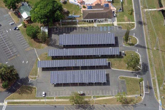 Parking canopies are one of the many photovoltaic projects reducing energy consumption on Fort Buchanan, Puerto Rico. A total of 21,824 solar photovoltaic panels will produce about 5.5 megawatts of power, which is at least 60 percent of the installation's current power demand at its peak production.