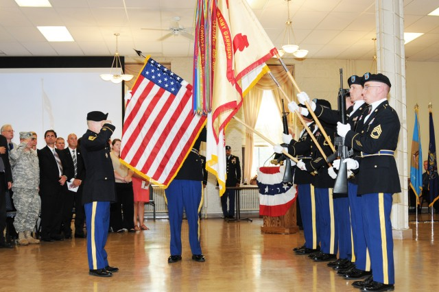 Master Sgt. Fernando Navarrete, Commander of Troops, salutes the flag as it is lowered by the color guard for retreat, during the Rock Island Arsenal Community Retirement and Retreat Ceremony, July 31.
