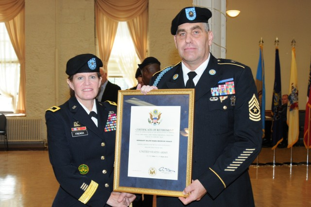 Brig. Gen. Kristin K. French, commanding general, Joint Munitions Command, presents Sergeant Major Mark Nissen his Certificate of Retirement following 30 years of service to the United States Army. Nissen was formally recognized during the Rock Island Arsenal Community Retirement and Retreat Ceremony, July 31.