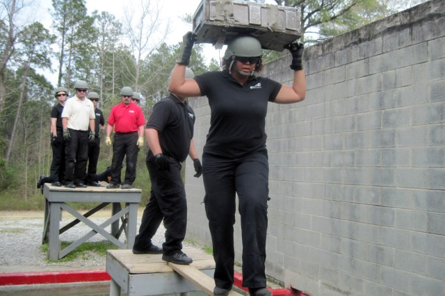 Cicely Simmons participates in a leadership reaction course at Fort Benning, Georgia, as part of the DOD Executive Leadership Development Program.