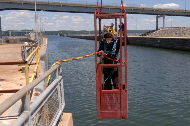 Diver Dustin Kelley, Nashville District Dive Team, is lowered into Pickwick Lock in Counce, Tenn., to inspect the lock gate and miter seal after the gate shook and experienced a malfunction early in the morning July 28, 2014. (USACE photo by Leon Roberts)