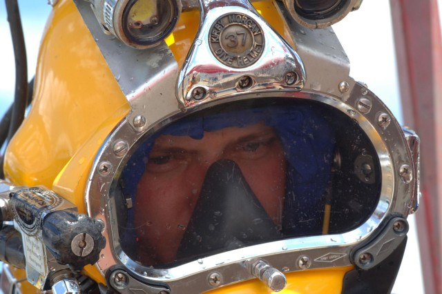Diver Dustin Kelley, Nashville District Dive Team, looks out of his dive helmet after diving in Pickwick Lock in Counce, Tenn., to inspect after the gate shook and experienced a malfunction July 28, 2014. (USACE photo by Leon Roberts)