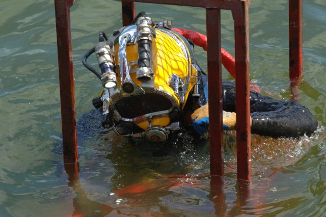 Diver Dustin Kelley, Nashville District Dive Team, descends into Pickwick Lock in Counce, Tenn., to inspect the lock gate and miter seal after the gate shook and experienced a malfunction early in the morning July 28, 2014. (USACE photo by Leon Roberts)