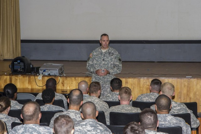 Col. John D. Kline, commander, 3rd Combat Aviation Brigade speaks to Soldiers at a town hall meeting July 28 at the theater on Hunter Army Airfield. The intent was to foster a command climate where Soldiers are not afraid to approach their leadership when they are frustrated, and build confidence their leaders will do their absolute best to gain resolution. (Photo by Sgt. William Begley, 3rd CAB Public Affairs)