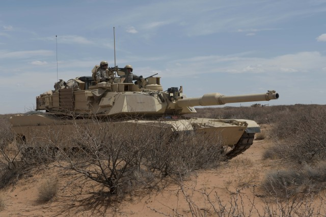 Soldiers with the 1st Battalion, 6th Infantry Regiment, move their M1 Abrams tank into a defensible position during a simulated battle at Network Integration Exercise 13.2 near Dona Ana, N.M., May 7, 2013. Leading experts in military combat-vehicle research, engineering and design gathered at Aberdeen Proving Ground, Maryland, July 29-31, 2014, to discuss a single goal: reducing the weight of the Army's tanks and infantry fighting vehicles by 40 percent in the coming decades.