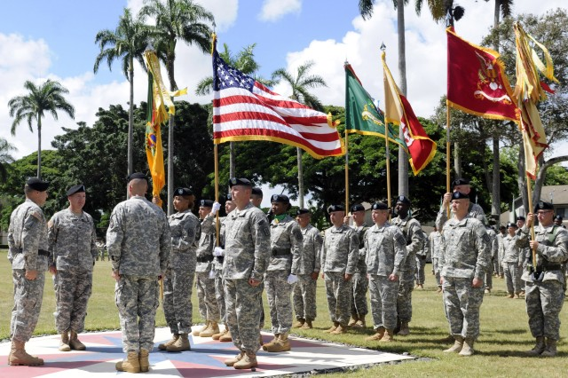 SCHOFIELD BARRACKS, Hawaii - The 8th Military Police Brigade held a change of command ceremony, here, at Hamilton Field July 31.  During which Col. Duane Miller assumed command of the 'Watchdog' Brigade from Col. Mark Jackson; also, within the ceremony, Command Sgt. Maj. Angelia Flournoy assumed responsibility of the 8th MP Bde.  (Photo by Staff Sgt. Richard Sherba, 8th Military Police Brigade Public Affairs, 8th Theater Sustainment Command)