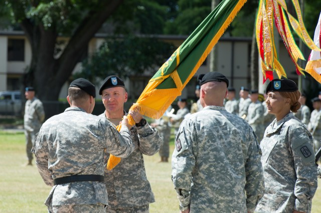 SCHOFIELD BARRACKS, Hawaii -  Maj. Gen. Edward  Dorman III, commander, 8th Theater Sustainment Command, passes the 8th Military Police Brigade Colors to Col. Duane Miller, commander, 8th Military Police Brigade, a tangible symbol of Col. Miller's assumption of command during a change of command ceremony held July 31 at Hamilton Field, here, in which Col. Miller assumed command of the 8th MP Bde. from Col. Mark Jackson.  (Photo by Staff Sgt. Daniel Garcia, 8th Military Police Brigade Public Affairs, 8th Theater Sustainment Command)