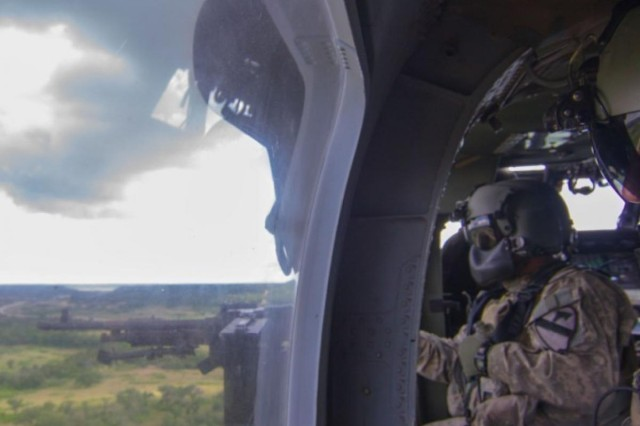 Sgt. Matthew Arambula, a crew chief for the 3rd Attack Helicopter Battalion, 227th Aviation Regiment, Air Cavalry Brigade, 1st Cavalry Division, on Fort Hood, Texas, readies to fire the M240H during his qualification. Once qualified, he will be able to instruct other Soldiers in the proper use of the weapon.