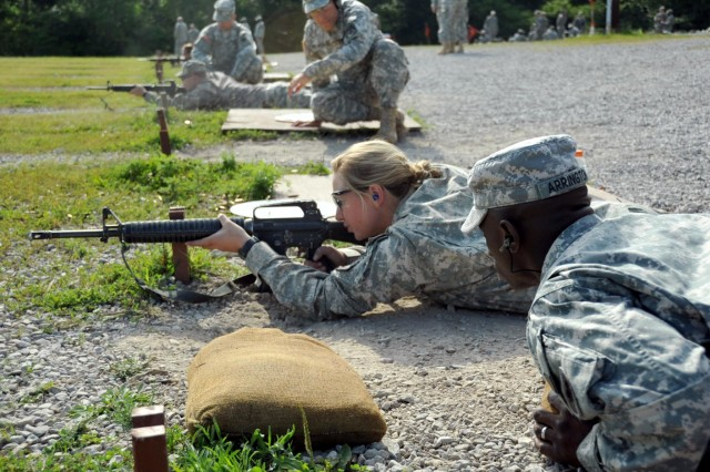 U.S. Army Staff Sgt. Raymond Arrington, instructor, basic rifle marksmanship committee, Task Force Wolf, coaches cadet Morgan Moxley, a Kansas State student, through the grouping and zeroing portion of the BRM lane during Cadet Summer Training (CST) on Fort Knox, Ky., July 25. The basic rifle marksmanship committee, comprised of Reserve Soldiers from 1st Battalion, 323rd Infantry Regiment, 2nd Brigade, 98th Training Division (Initial Entry Training), teach cadets the fundamentals of BRM, facilitate the mechanical zero process, and coach them through the grouping, zeroing and qualification with their assigned M16 rifle. (U.S. Army photo by Staff Sgt. Shejal Pulivarti/released)