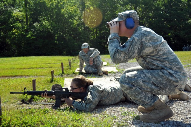 U.S. Army Sgt. Ben Royalty, instructor, basic rifle marksmanship committee, Task Force Wolf, checks the aim and accuracy of cadet Morgan Tadych, a Georgetown student, as she fires during the qualification portion of the BRM lane during Cadet Summer Training (CST) on Fort Knox, Ky., July 25. The basic rifle marksmanship committee, comprised of Reserve Soldiers from 2nd Brigade, 98th Training Division (Initial Entry Training), teaches cadets the fundamentals of BRM, facilitates the mechanical zero process, and coaches them through the grouping, zeroing, and qualification with their assigned M16 rifle. (U.S. Army photo by Staff Sgt. Shejal Pulivarti/released)