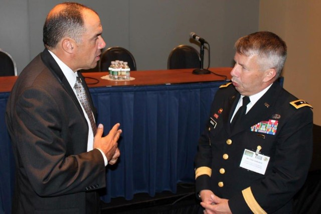 An Army Small Business Forum attendee speaks with Maj. Gen. Todd Semonite, deputy commanding general and deputy chief of Engineers, U.S. Army Corps of Engineers. The forum was part of the 2013 Association of the United States Army annual meeting.