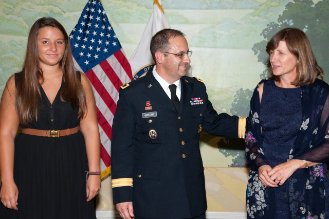 Maj. Gen. Harold J. Greene is accompanied by his daughter, Amelia, and his wife, Susan, at his promotion ceremony at the Fort Myer, Va., Officers Club, Aug. 30, 2012.