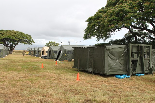 FORD ISLAND, Hawaii—Soldiers with the 962nd Quartermaster Company, 9th Mission Support Command, U.S. Army Pacific, setup the Mobile Integrated Remains Collection Systems during a humanitarian aid and disaster relief exercise in support of the Rim of the Pacific exercise that ran from June 26 to Aug. 1. Twenty-two nations, more than 40 ships and submarines, about 200 aircraft and 25,000 personnel are participating in Exercise RIMPAC from June 26 to Aug. 1 in and around the Hawaiian Islands and Southern California. The world's largest international maritime exercise, RIMPAC provides a unique training opportunity that helps participants foster and sustain the cooperative relationships that are critical to ensuring the safety of sea lanes and security on the world's oceans. RIMPAC 2014 is the 24th exercise in the series that began in 1971. (U.S. Army photo by Staff Sgt. Kyle J. Richardson, USARPAC PAO)