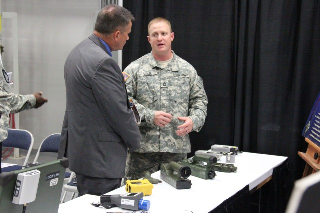 Sgt. 1st Class Nicholas Siegel, 22nd CBRNE Battalion, describes 20th CBRNE Response Team (Field Analytics) tools during the Team CBRNE Capabilities Showcase, Aug. 6, 2014, at Aberdeen Proving Ground, Md.