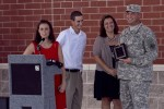 Scialdo brother and sisters with Staff Sgt. Matt Loebs