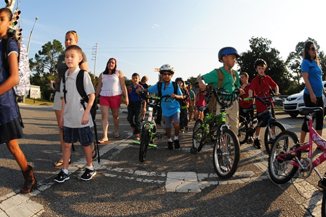 Students cross the street on their bikes, on foot and with their Families during the first day of school at Fort Rucker Elementary School Aug. 5.