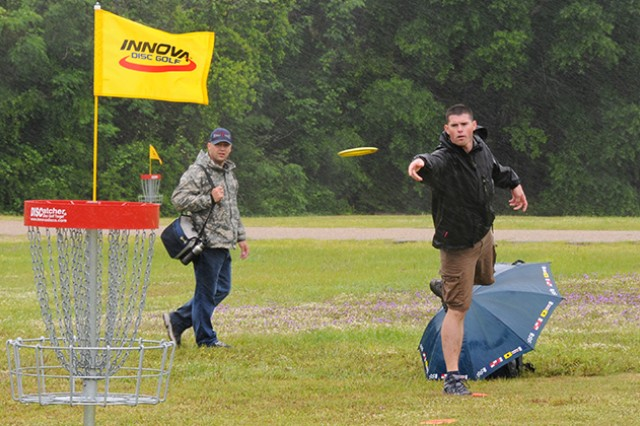 James Old, winner of male 18-45 category, throws a disc at the first hole during Fort Rucker's first Flying Disc Golf Tournament last year.