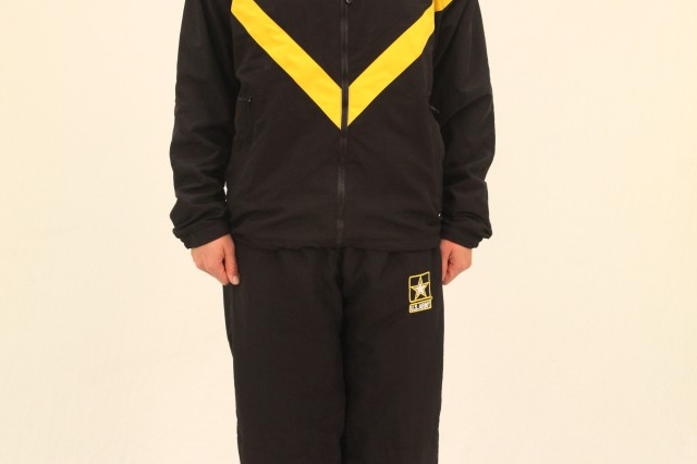 Capt. Leala McCollum poses in the Army Physical Fitness Uniform running jacket and pants.