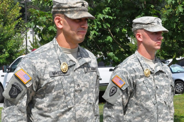 New York Army National Guard Sgt. Sean Massimo, 442nd Military Police Company, Jamaica, N.Y., and Staff Sgt. Jeffrey Dorvee, 1427th Transportation Battalion, Queensbury, N.Y., pose after receiving the German Armed Forces Proficiency Badge to during a ceremony at Camp Smith Training Site, N.Y., Aug. 3, 2014. The decoration is traditionally awarded to German enlisted soldiers for weapons proficiency, and is one of the few foreign awards approved for wear by U.S. military personnel.