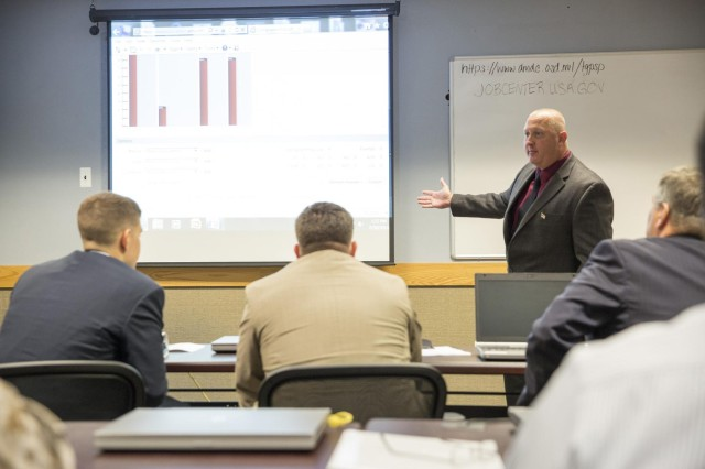 Retired U.S. Army Sgt. Maj. Ed Dunn, deputy director of field operations at Serco, demonstrates a new software that will allow commanders access to daily reports of their units' progress in the ACAP program on the Fort Myer portion of Joint Base Myer-Henderson Hall July 30, 2014. The brief was for visiting staff members from Sen. Patty Murray's, D-Wash., office.