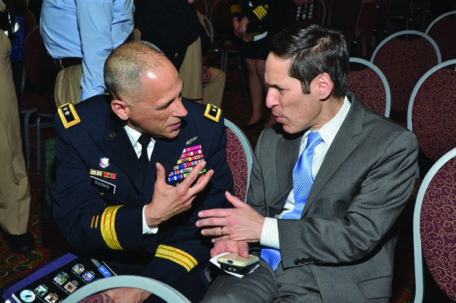 Maj. Gen. Dean G. Sienko, commander, U.S. Army Public Health Command, and Dr. Thomas Frieden, director, U.S. Centers for Disease Control and Prevention, Atlanta, discuss opportunities for collaboration.