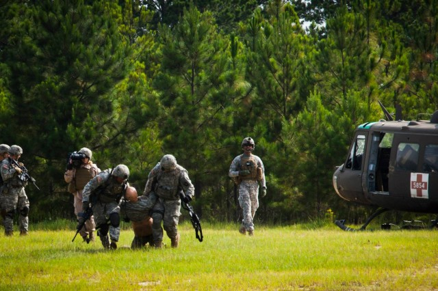 Soldiers with 1st Battalion, 187th Infantry Regiment, 3rd Brigade Combat Team, 101st Airborne Division (Air Assault), evacuate a simulated casualty during convoy live-fire training at the Joint Readiness Training Center, July 19, 2014, Fort Polk, La. The Soldiers from 3rd BCT, equipped with the Army's newest tactical communications gear, conducted a series of training missions at JRTC, focusing on the skill sets that will be employed during the unit's upcoming deployment in support of Operation Enduring Freedom.