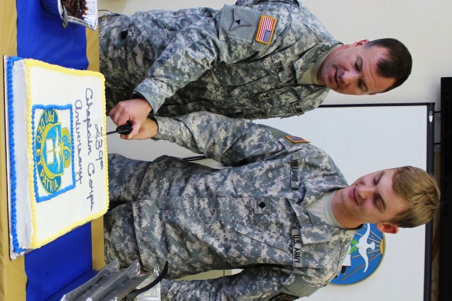 From left, Col. Thomas Boone, Fort Huachuca garrison commander, and Spc. Adam Williams, chaplain assistant, 309th Military Intelligence Battalion, cut the cake to mark the 239th Chaplain Corps Anniversary. The event took place after lunch Aug. 1 in the Main Post Chapel Activity Room.