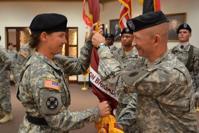 U.S. Army Col. Matthew D. Redding, outgoing 598th Transportation Brigade commander, passes the brigade's colors to Maj. Gen. Susan A. Davidson, commanding general, Military Surface Deployment and Distribution Command, thereby relinquishing his command of the brigade Aug. 7 at the Sembach Community Activity Center. (U.S. Army photo by A.J. Bosker)