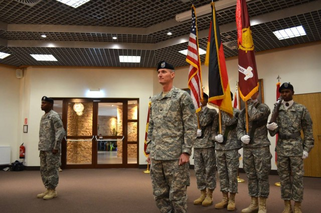 U.S. Army Col. Layton G. Dunbar Jr., 598th Transportation Brigade commander, prepares to sing the Army song during the brigade's change of command ceremony Aug. 7 at the Sembach Community Activity Center. (U.S. Army photo by A.J. Bosker)